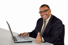 Smiling businessman with laptop posing thumbs up Stock Photos
