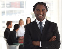 Smiling businessman leader Stock Photography
