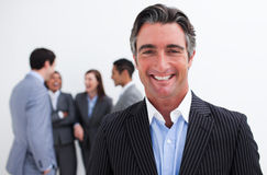 Smiling businessman leading her team Royalty Free Stock Image