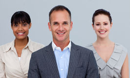 Smiling businessman leading his colleagues Royalty Free Stock Photos
