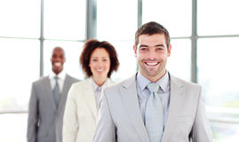Smiling businessman leading his colleagues Royalty Free Stock Images