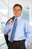 Smiling Businessman Leaving The Office Royalty Free Stock Photo