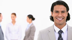 Smiling businessman looking at the camera Stock Photo