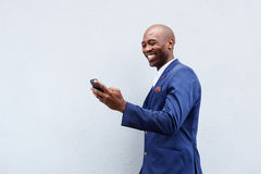 Smiling businessman looking at cellphone Royalty Free Stock Photo