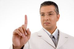 Smiling businessman looking his finger Royalty Free Stock Images