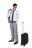 Smiling businessman looking at his suitcase Stock Photography