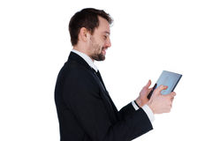 Smiling businessman looking at his tablet-pc Stock Photography