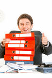 Smiling businessman looking out from folders Royalty Free Stock Images