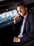 Smiling businessman in luxury car Royalty Free Stock Images