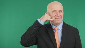 Smiling Businessman Make Call Me Hand Gestures royalty free stock photo