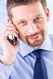 Smiling businessman making a phone call. Royalty Free Stock Photography