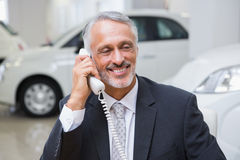 Smiling businessman making a phone call Stock Photos