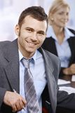 Smiling businessman at meeting Stock Image