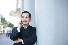 Smiling businessman with mobile phone Stock Photo