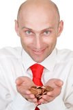 Smiling businessman with money. Portrait of smiling young businessman with pile of money in hands, isolated on white background stock image
