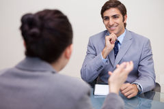 Smiling businessman in a negotiation Stock Photos