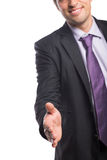 Smiling businessman offering a handshake Royalty Free Stock Photos