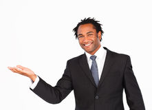 Smiling businessman offering his hand Stock Photography