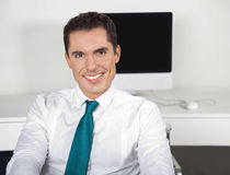 Smiling businessman in office Stock Photos