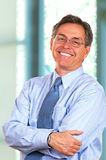 Smiling Businessman In Office Setting Royalty Free Stock Photos