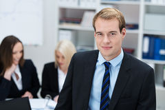 Smiling businessman in the office Royalty Free Stock Photo