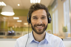 Smiling Businessman in the office on video conference, headset, Stock Image
