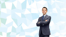 Smiling businessman over blue low poly texture Stock Images