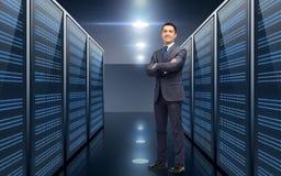 Smiling businessman over server room background Stock Images