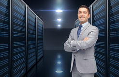 Smiling businessman over server room background Royalty Free Stock Image