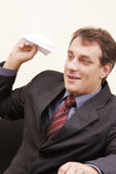 Smiling businessman with paper plane Royalty Free Stock Photography