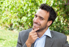Smiling businessman in the park Stock Image
