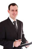 Smiling businessman with pen and notepad Royalty Free Stock Photography