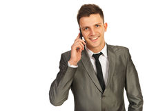 Smiling businessman by phone Royalty Free Stock Image