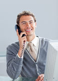 Smiling businessman on phone at his desk Stock Photos