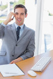 Smiling businessman on the phone looking at camera Royalty Free Stock Images