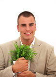 Smiling businessman with a plant Royalty Free Stock Image