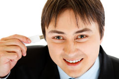Smiling businessman plugging flash drive into head Royalty Free Stock Photography