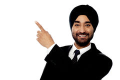 Smiling businessman pointing away Royalty Free Stock Photo
