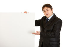 Smiling  businessman pointing at blank billboard Royalty Free Stock Photo