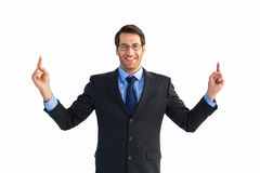 Smiling businessman pointing with both fingers Royalty Free Stock Photos