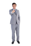 Smiling businessman pointing at the camera Royalty Free Stock Images
