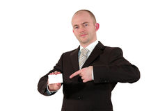 Smiling businessman pointing at a card Stock Photo