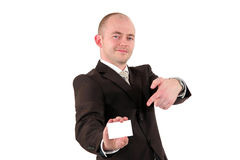 Smiling businessman pointing at a card Royalty Free Stock Images