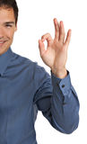 Smiling Businessman Pointing Finger OK sign Royalty Free Stock Photo
