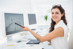 Smiling businessman pointing her computer Royalty Free Stock Photography