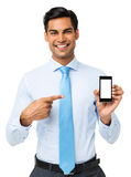 Smiling Businessman Pointing At Smart Phone Stock Photography