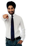 Smiling businessman pointing towards you Royalty Free Stock Photography