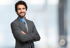 Smiling businessman portrait against bright background Stock Images