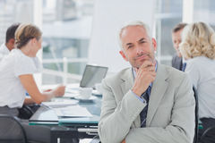 Smiling businessman posing in the boardroom Royalty Free Stock Image