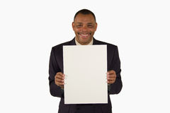 Smiling businessman presenting a picture board Royalty Free Stock Photo